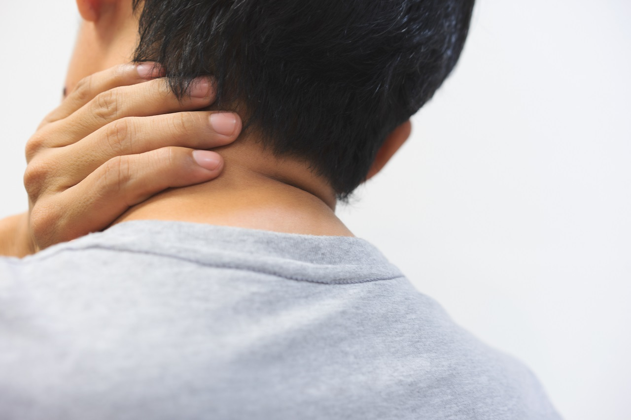 Close up of a man touching his neck due to pain