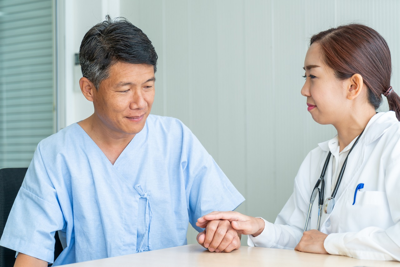 An old asian man having a doctor's appointment pre-surgery