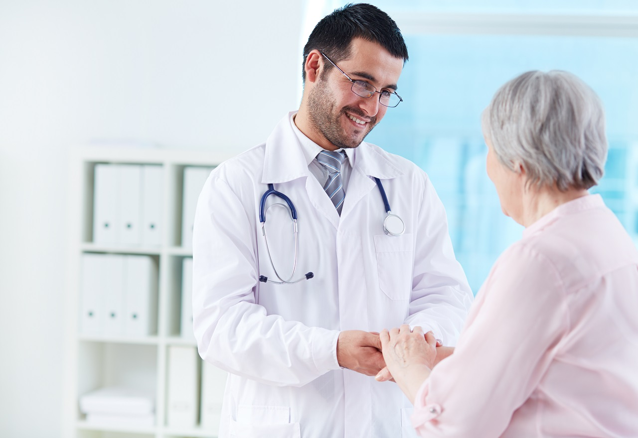 A doctor talking with an elderly patient