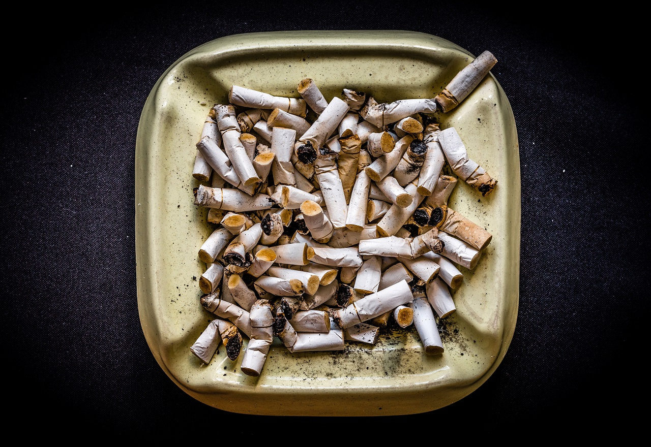 An ash tray full of used cigarettes