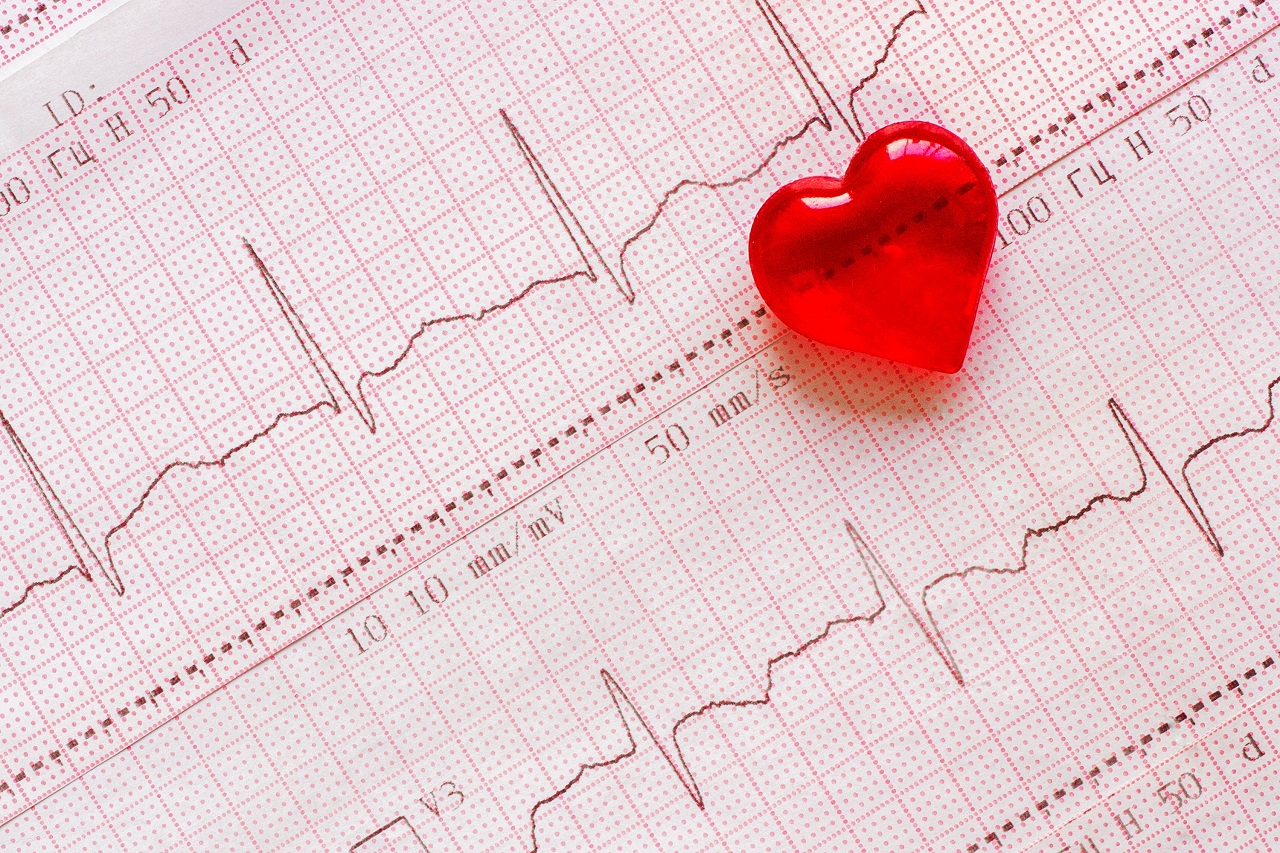 A small red heart on top of a cardiogram