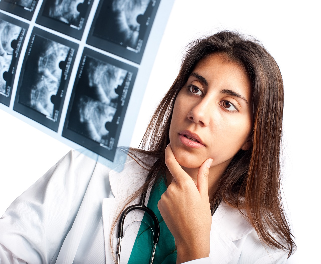 A doctor looking at a breast ultrasound
