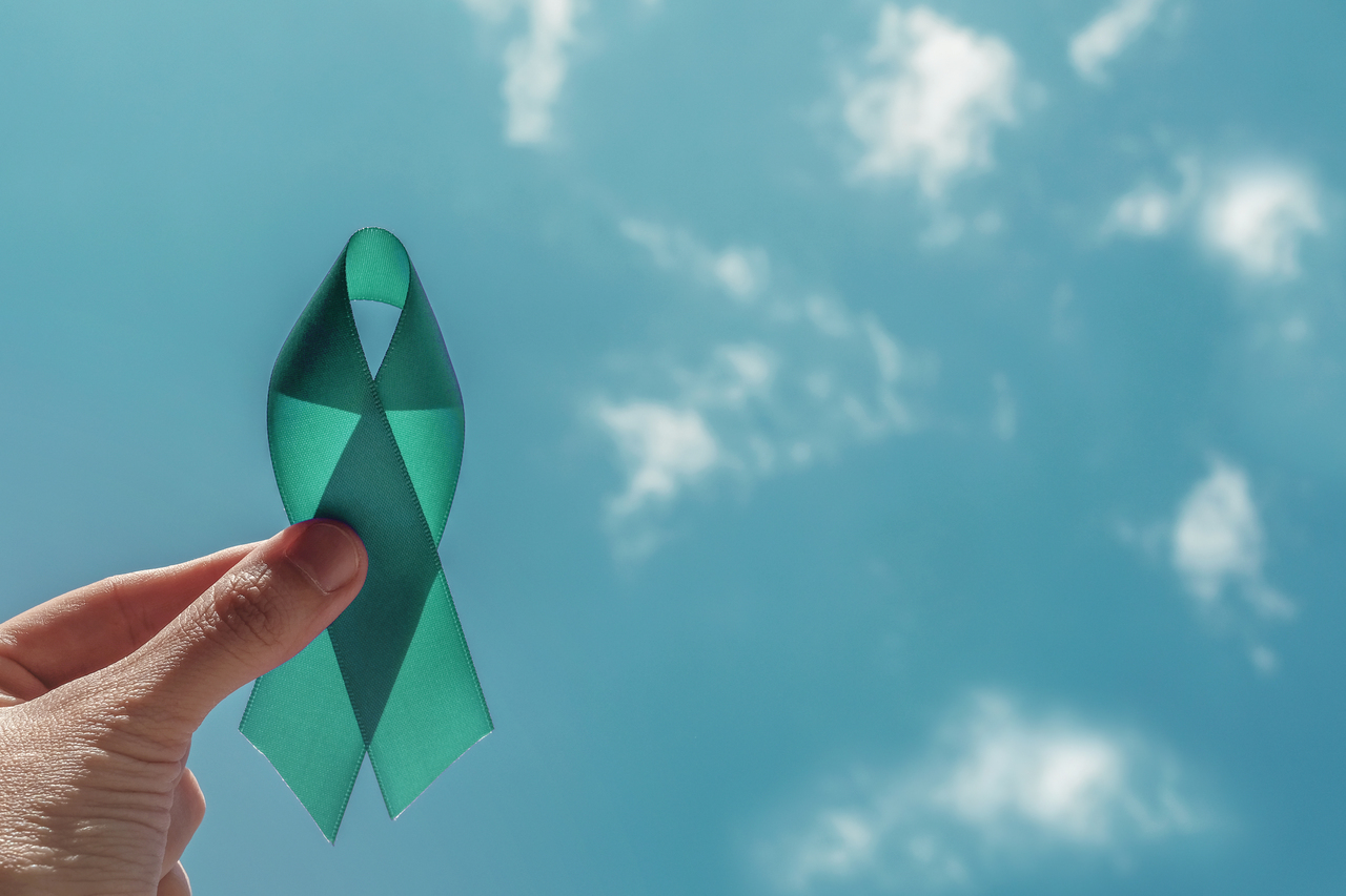 A teal ribbon signifying fight against cervical cancer