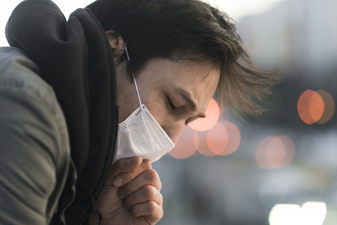 Close up of a man with pneumonia coughing