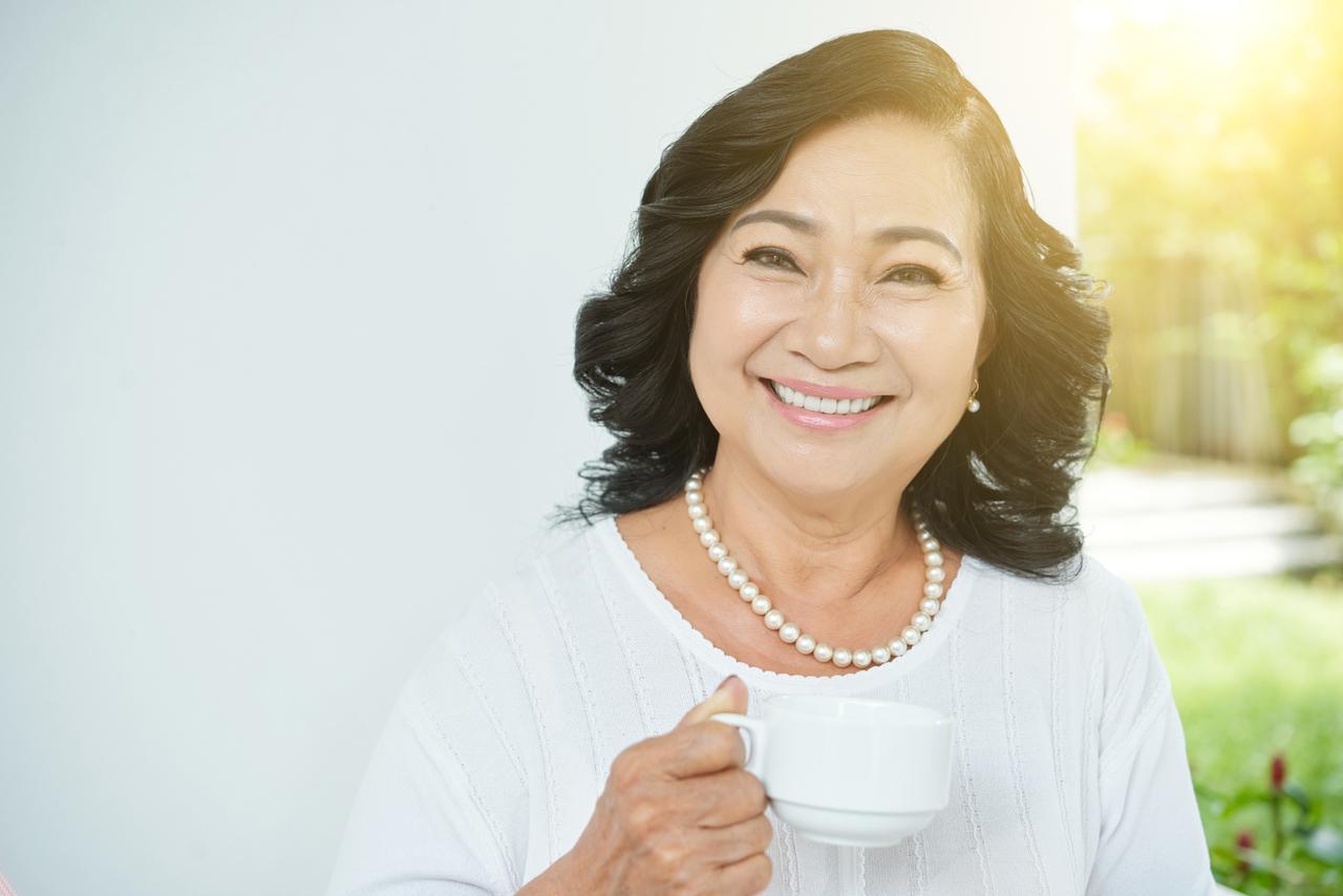 A happy elderly Asian woman