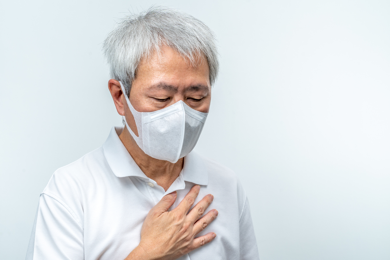 An old man with COVID-19 wearing a face mask