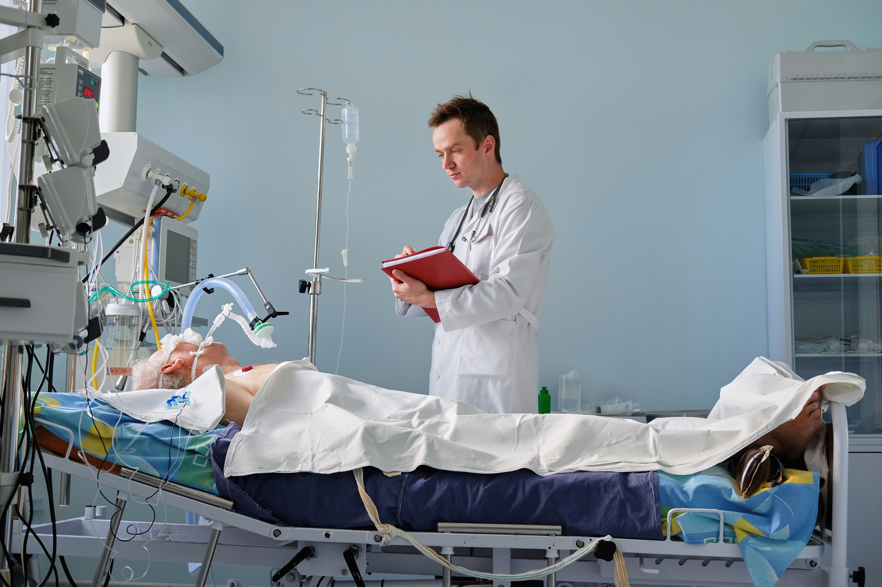 A man on a medical ventilator due to COVID-19